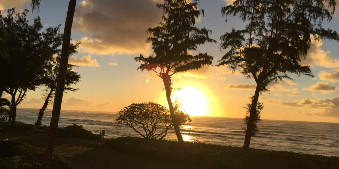 Sunrise panoramic view from one edge of lanai at Islander on the Beach Kauai