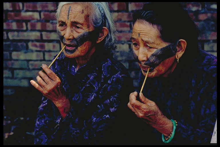 Photo: Two atayal elder women with traditional facial tattoos