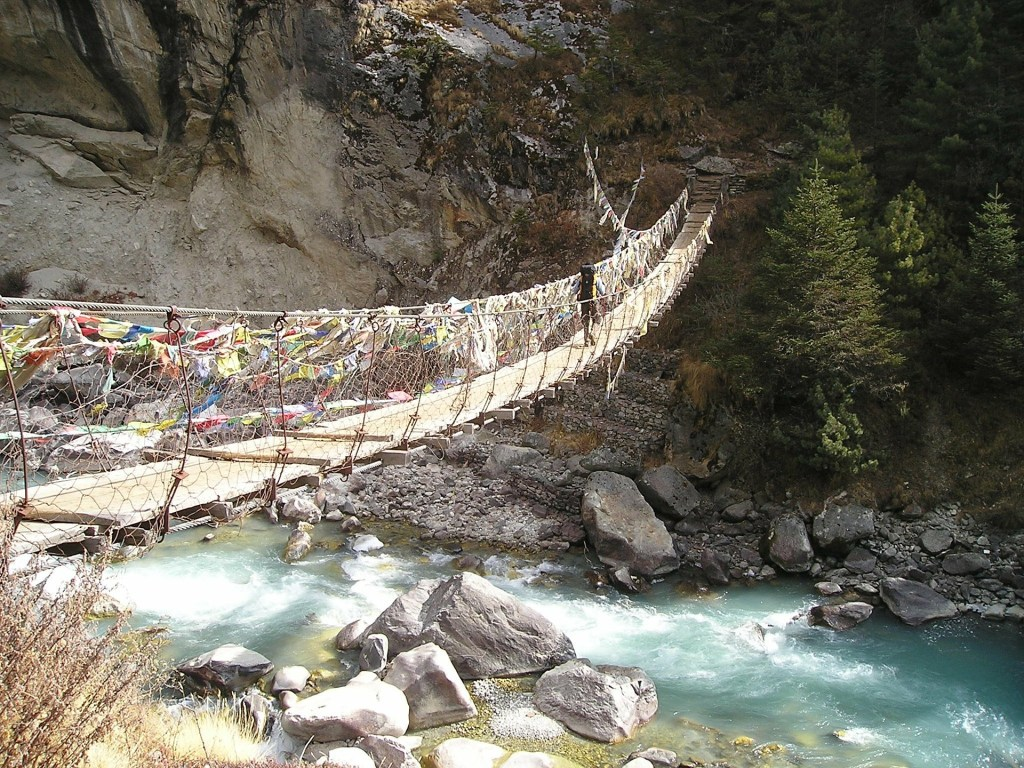 Photo: Primitive suspension bridge over river