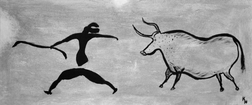 Photo: Cave art of man and ox