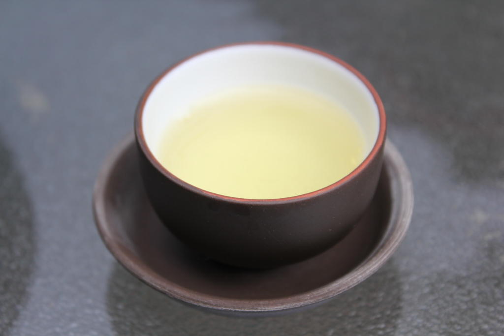 Photo: small tea cup with oolong tea used traditionally in Taiwan