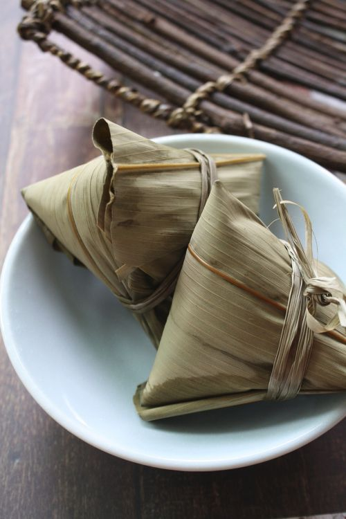 Photo: Rice dumplings wrapped in bamboo leaves