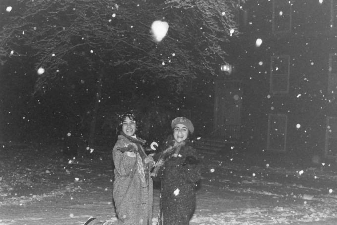 two women playing in snow