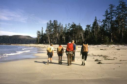 This image was flipped when scanned. This is at Experiment Bight, eastern section walking towards the west just before the middle beach section. Bill Hill blue shirt. Ruth Masters red clothing brown backpack.