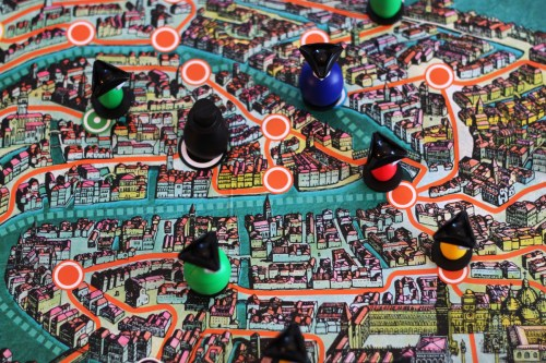 A complex network of spies on a complex network of streets