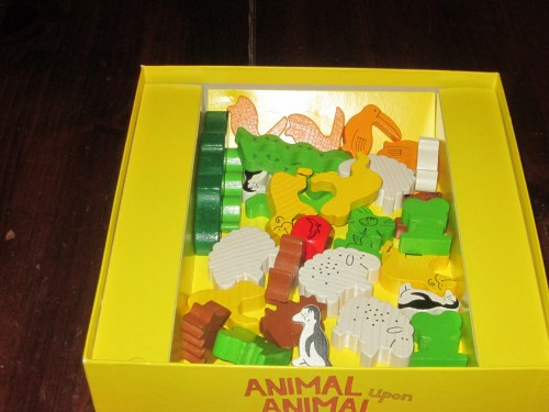 Included in the box are seven different animals, four of each; one alligator; and one red die. Also instructions in several languages.