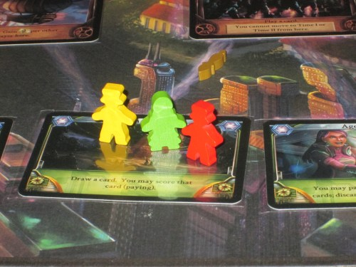 The players on the start card in Temporum. The player pieces are cut in both male and female shapes.