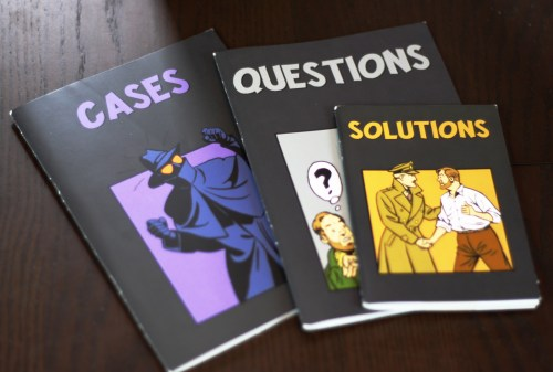"These are the casebooks for the group. The ""Cases"" book includes some patter that sets the grounds for the case, the ""Questions"" book offers what players are trying to solve, and the ""Solutions"" book tells the players why they are wrong."