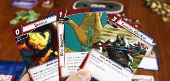 A hand of Spider-Man cards; Backflip, Web-Shooter, Swinging Web Kick