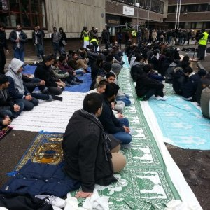 Muslim students hold their prayers outside City University. Image: Kitty Teague