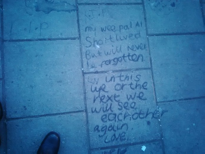 Message left on pavement in commemoration of Alan Cartwright