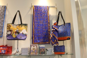 Brightly colored arabesque patterns adorn scarfs and ladies bags.
