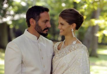 PR - 2 - The newly married couple enjoy a moment together on their wedding day. Photo - TheIsmaili Gary Otte