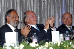 Kenya, 2011 - Mawlana Hazar Imam applauds during the institutional dinner, together with Ismaili Council President Aitmadi Zul Abdul and AKDN Resident Representative Aitmadi Aziz Bhaloo (Photo: The Ismaili/Aziz Islamshah)