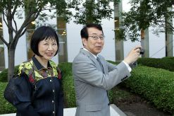 Japanese Ambassador Kenjiro Monji, right, takes a photo while on a tour of the Delegation of the Ismaili Imamat building with his spouse, Etsuko Monji, at the July 7 celebration of the anniversary of the appointment of the Aga Khan, the spiritual leader of Ismaili Muslims. (Image credit: The Hill Times / Sam Garcia)