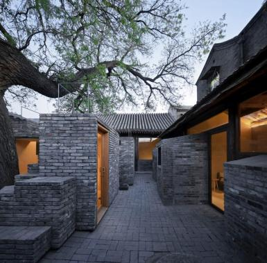 Concrete with Chinese ink, recycled grey brick and warm plywood. Aga Khan Award for Architecture 2016 Winner: Hutong Children's Library and Art Centre Beijing, China