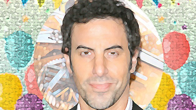 October 13 – Sacha Baron Cohen gets advice from a man in a suit in a kiosk on a street