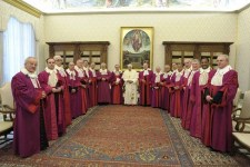 Pope Benedict XVI poses during a meeting with Roman Rota members at the Vatican