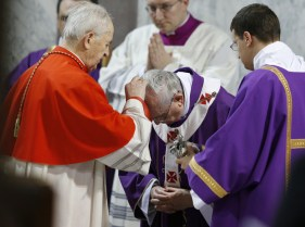 Pope Francis receives ashes from Cardinal Tomko during Ash Wednesday Mass at Basilica of Santa Sabina in Rome