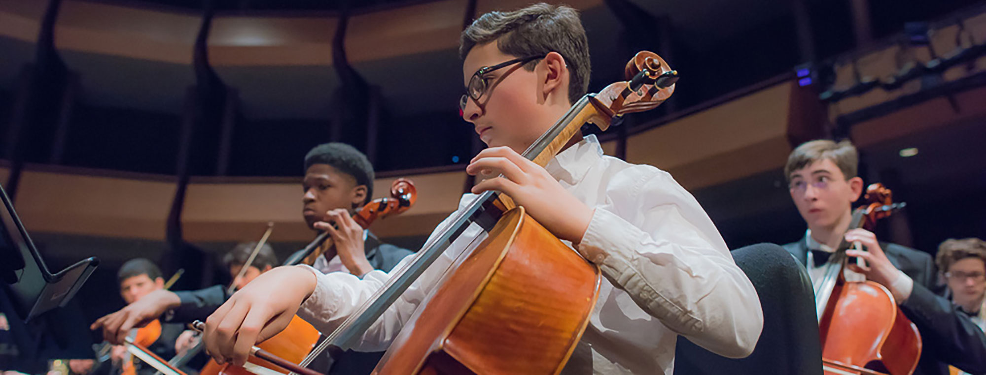 Young Class Playing Cello