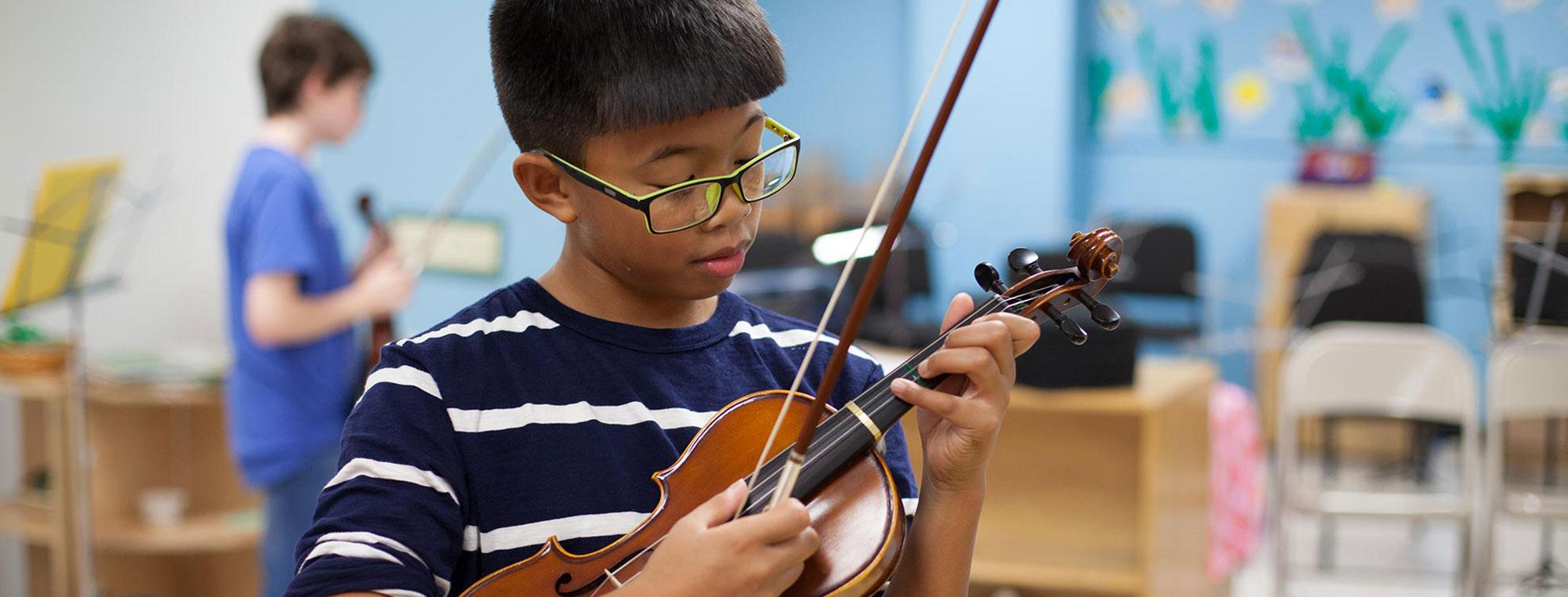 Child Strumming Violin