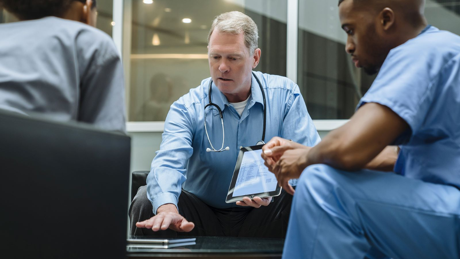 Doctor using iPad for NHS login authentication
