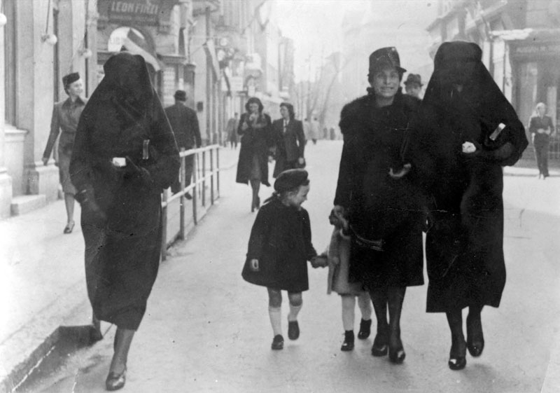 Zejneba Hardaga-Susic and Rivka Kavilio with their daughters on a street in Sarajevo, Yugoslavia (1941)