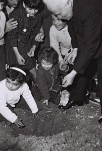 Israeli Prime Minister David Ben Gurion planting trees with kindergarten children on Tu Bishvat, 1963