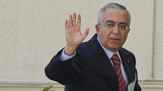Salam Fayyad waves as he arrives for a meeting of the Palestine Liberation Organization after tendering his resignation to President Mahmoud Abbas in the West Bank city of Ramallah