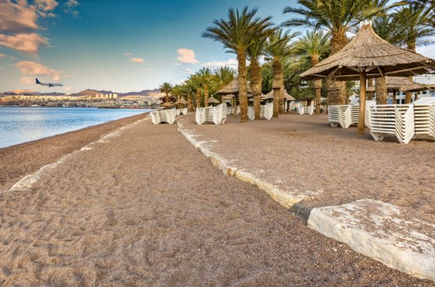 Sandy beach in the early morning in Eilat - famous resort city in Israel