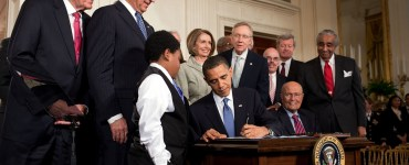 Obama signs Obamacare into law