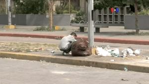 Venezuelans eating garbage