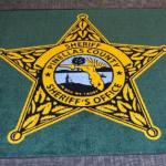 'In Dog We Trust' Mistakenly Printed on Florida Sheriff's Office Rugs