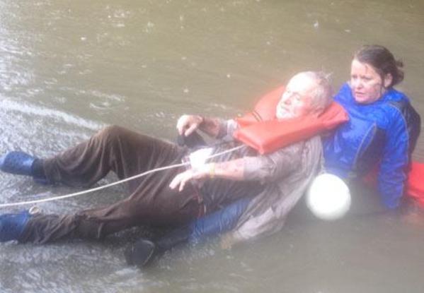 elderly man and dog rescued in south carolina flood