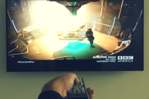Hand with Remote Pointed at TV