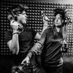 Black and white photo of two people playing with virtual reality headset