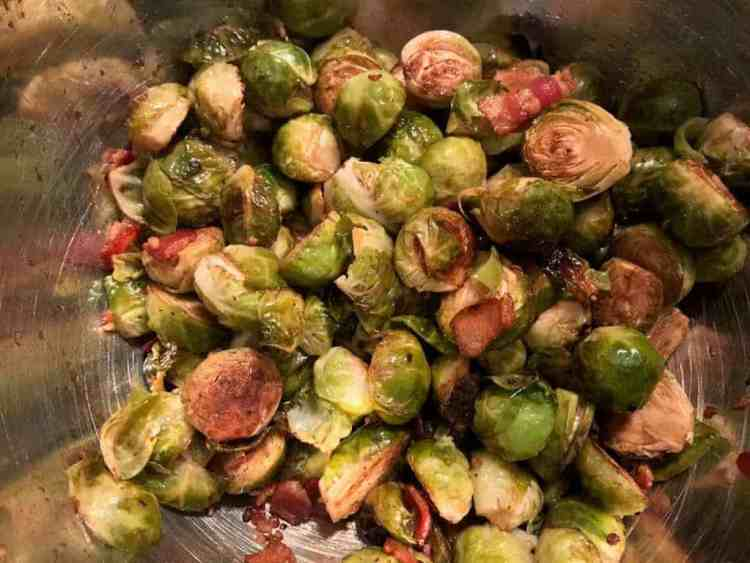 Roasted brussel sprouts tossed with bacon and balsamic