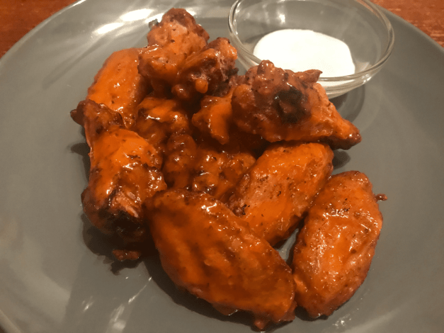 air fryer chicken wings on a plate with blue cheese