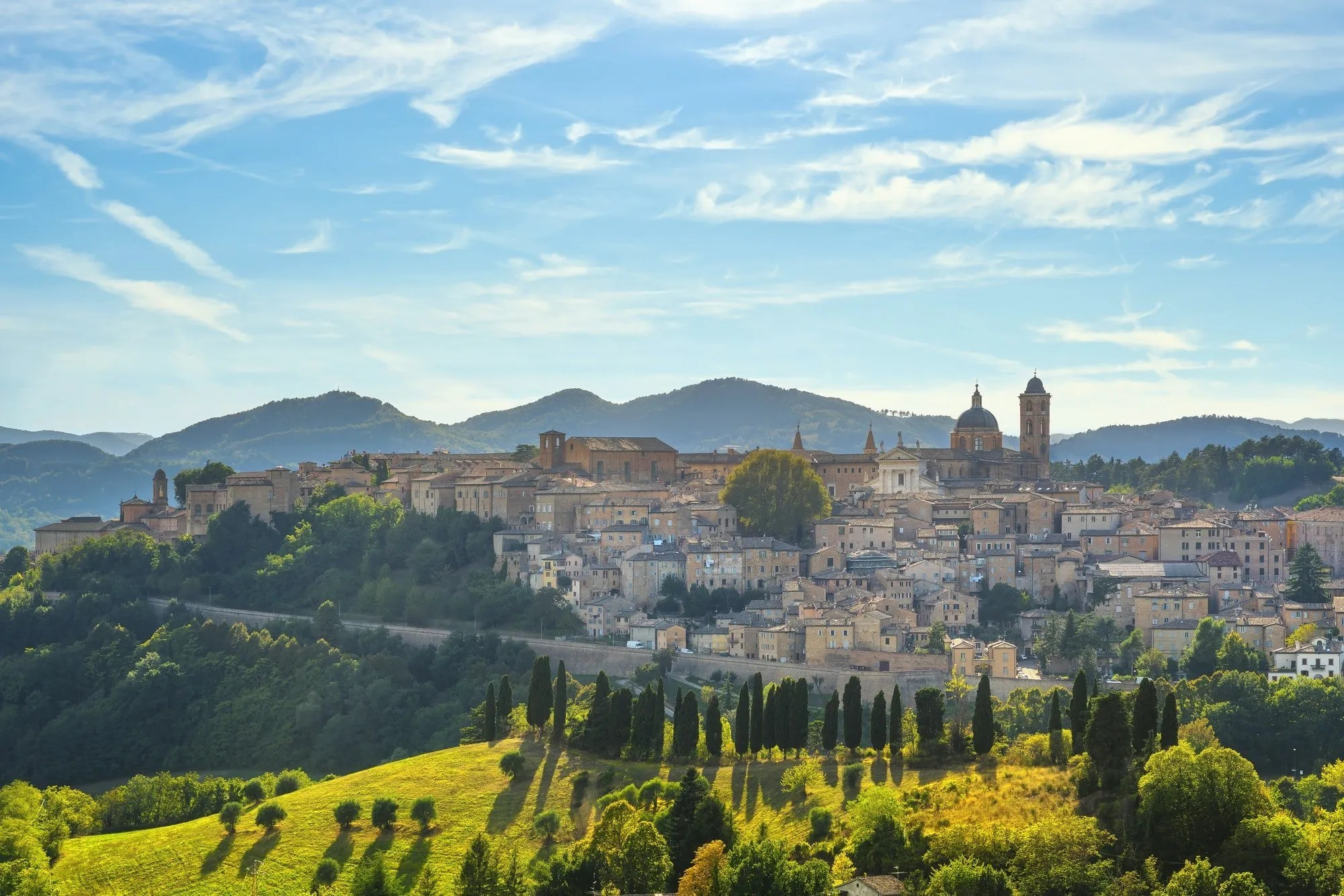 Urbino city skyline and countryside landscape. Marche region, Italy.