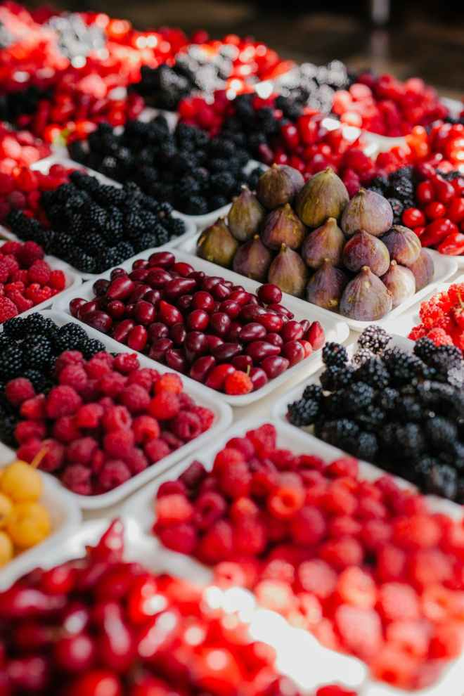 fresh berries on trays in market