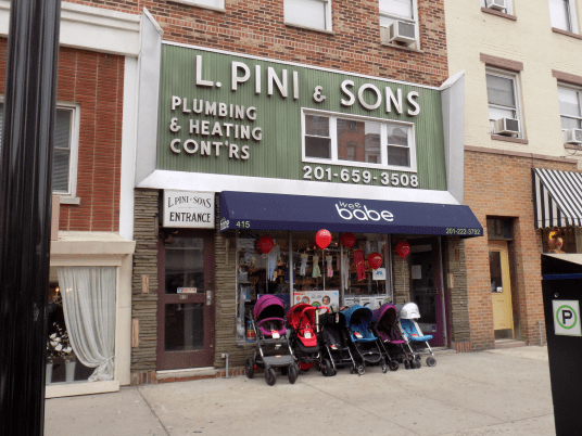 Another example of signage being maintained as a new business sprouts in Hoboken, New Jersey