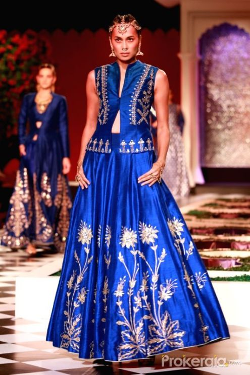 a-model-walks-the-ramp-displaying-an-outfit-by-438283