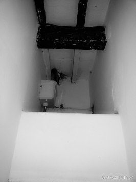 Area above toilet room with water tank