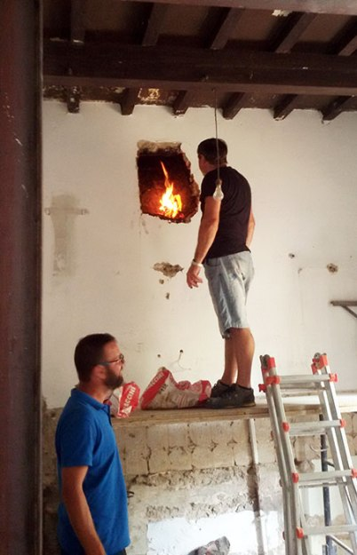 Checking the chimney exhaust with fire and smoke for future kitchen