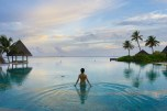 girl in the swimming pool of maldives resort