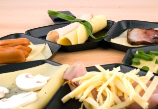 Raclette pans with food, ideal for party