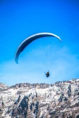 Paragliding fly over the Alps