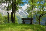 Bench with a magnificent view in a small park the Swiss alps near Murren and Grindlewald.