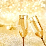 188073205-Flutes of champagne with bubbles behind