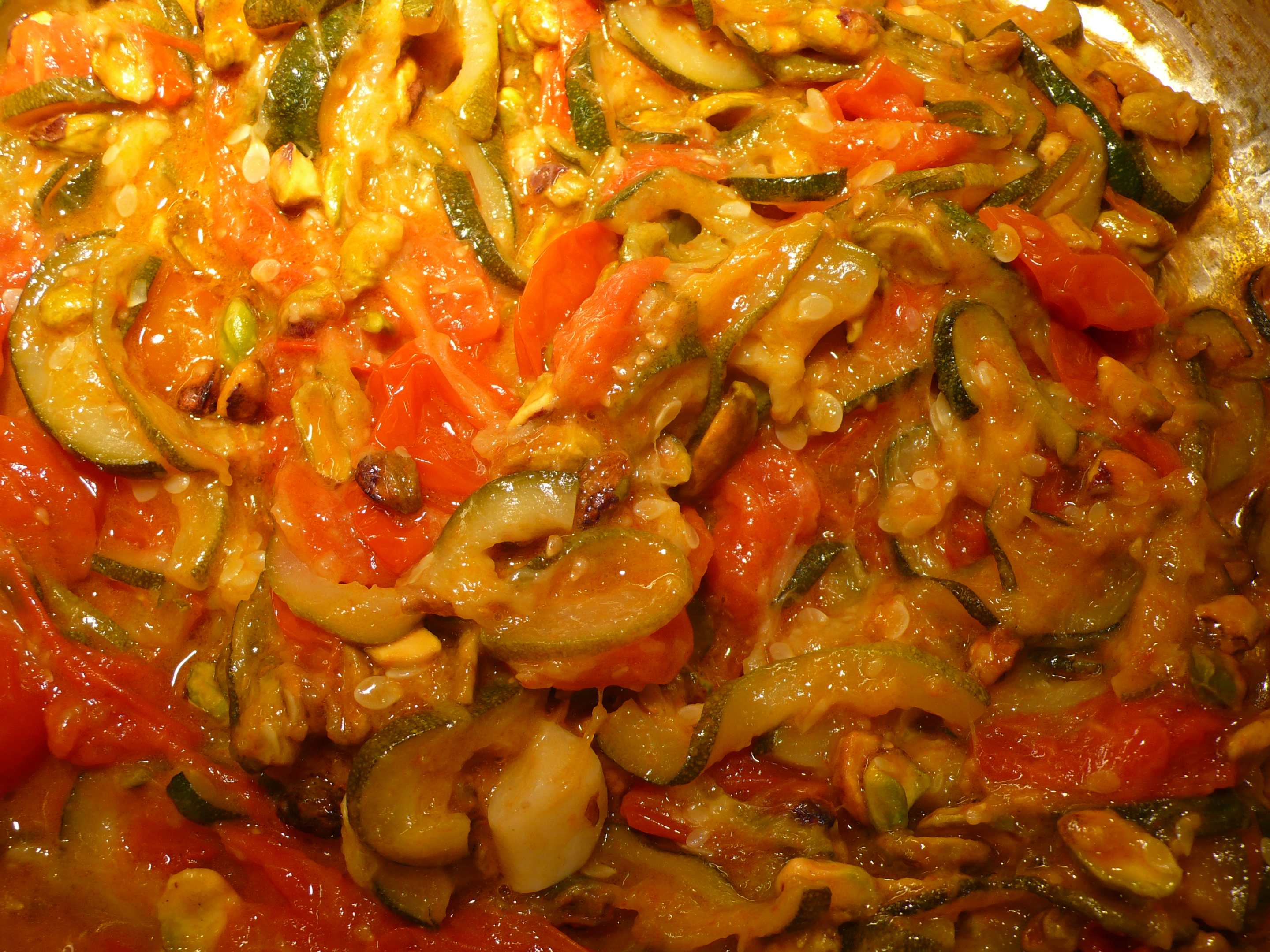zucchini, roasted tomatoes and pistachios